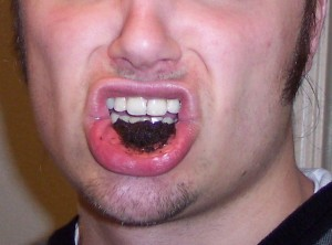 Dipping_tobacco_in_mouth